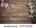 flowers on wooden background | Shutterstock . vector #379718509