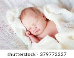 newborn sleeping baby girl on a ... | Shutterstock . vector #379772227