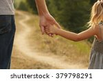 a the parent holds the hand of... | Shutterstock . vector #379798291