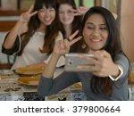 friends taking picture in...   Shutterstock . vector #379800664
