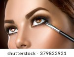 makeup. woman make up applying... | Shutterstock . vector #379822921