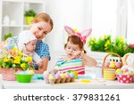 happy family mother and two... | Shutterstock . vector #379831261
