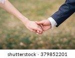 bride and groom holding hands   Shutterstock . vector #379852201