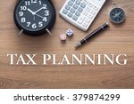 Small photo of Tax Planning words written on wooden table with clock,dice,calculator pen and compass