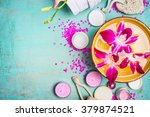 bowl with water and pink orchid ... | Shutterstock . vector #379874521