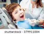 little boy at the dental office.... | Shutterstock . vector #379911004