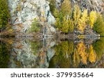 The colors of autumn are reflected in the calm waters of the Michigamme River in Michigan