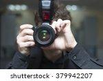 men's hands held camera closeup  | Shutterstock . vector #379942207