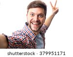 Happy Young Man Taking A Selfi...