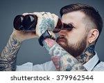 Bearded Tattooed Man Looking...