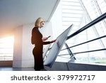 female architect holding cell... | Shutterstock . vector #379972717