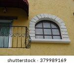 white window on yellow cement... | Shutterstock . vector #379989169