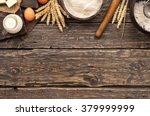 Flour In A Wooden Bowl On Dark...
