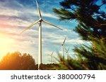 white wind turbine located... | Shutterstock . vector #380000794