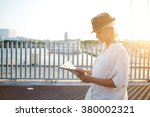 Charming Female Tourist Readin...