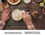 man eating breakfast oatmeal... | Shutterstock . vector #380003281