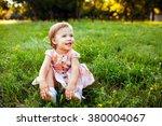 little girl sitting on the...   Shutterstock . vector #380004067