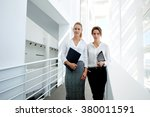 serious female colleagues... | Shutterstock . vector #380011591