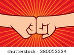 two fists punching each other    Shutterstock .eps vector #380053234
