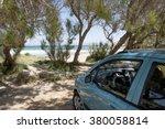Green Car Park On Sand Beach...