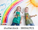 kids painting rainbow | Shutterstock . vector #380062921
