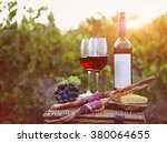 two glasses of red wine with... | Shutterstock . vector #380064655