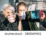 cool fashionable girls taking a ... | Shutterstock . vector #380069401