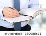 the business man writing in the ... | Shutterstock . vector #380085631