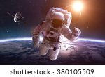 astronaut in space over the... | Shutterstock . vector #380105509