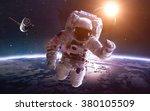 astronaut in space over the... | Shutterstock . vector #380105509