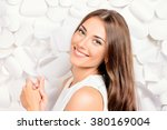 smiling young woman in white... | Shutterstock . vector #380169004