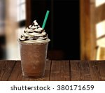 Frappuccino On Wooden Table At...