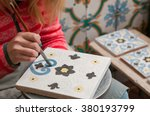 a pottery decorator painting a... | Shutterstock . vector #380193799