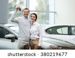 couple buying a car in... | Shutterstock . vector #380219677