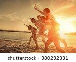 friends fun on the beach under... | Shutterstock . vector #380232331