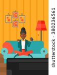 woman playing video game. | Shutterstock .eps vector #380236561