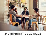 young people sitting at a cafe... | Shutterstock . vector #380240221