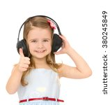 Small photo of Joyful little girl in a big , black stereo headphones listens to music. Girl shows a sign with his hand All right . Closeup - Isolated on white background