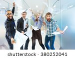 Small photo of Group of joyful excited business people throwing papers and having fun in office
