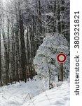 Small photo of Moving interdict road sign in winter forest, snowy weather