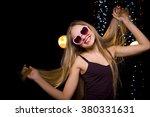 beautiful girl dancing in a... | Shutterstock . vector #380331631