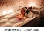 woman lying in tub doing... | Shutterstock . vector #380343001