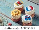 summer cupcakes on blue planks   Shutterstock . vector #380358175