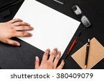 hands on the table with a4... | Shutterstock . vector #380409079