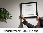business woman hanging framed