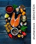 raw steak of salmon with fresh... | Shutterstock . vector #380419324