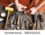 man working with leather using... | Shutterstock . vector #380426431