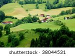 Green landscape and houses in the German alps - stock photo