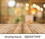 wooden board empty table in... | Shutterstock . vector #380447449