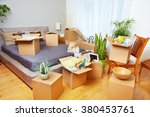 moving boxes in new house. | Shutterstock . vector #380453761